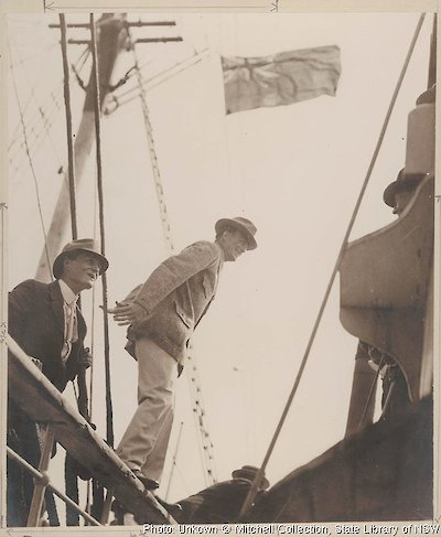 Madigan (left) and Mawson about to step from the rail of the Aurora onto the customs tender Adelaide